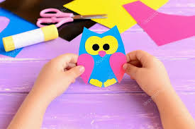 Depositphotos 121758124 Stock Photo Small Child Holds Paper Owl