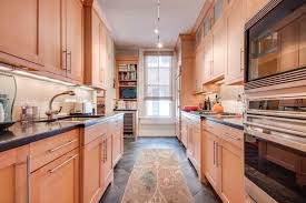 A Contemporary Light Wood Galley Kitchen With Diamond Pattern Dark Tile Floor High
