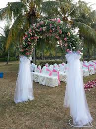 Elegant White Transparent Cloth Matched With Rustic Wedding Arch Flowers And Beautiful Pink Arrangements Also Lovely Guests