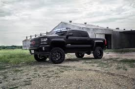Off- Road Enthusiast Dream: Black Lifted Silverado With Custom Parts ...