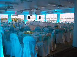 Blue Uplighting Sets The Mood For An Open Air Wedding Reception On Second Story Deck Of Clearwater Community Sailing Sand Key