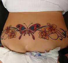 Butterfly And Orchid Flowers Tattoo On Lower Back