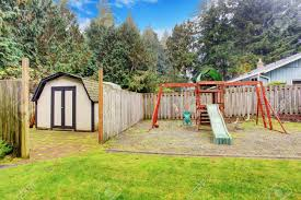 Backyard With Small Shed And Playground For Kids Stock Photo ... Landscaping Ideas Kid Friendly Backyard Pdf And Playgrounds Playground Accsories A Sets For Amazoncom Metal Swing Set Swingset Outdoor Play Slide For Children Round Yard Kids Free Images Grass Lawn Summer Young Park Backyard Playing Home Decor Design Steel Discovery Prairie Ridge All Cedar Wood With Patio Area And Stock Photo Refreshing Your Kids Carehomedecor Fun Ways To Transform Your Into A Cool Weston Walmartcom Backyards Bright Small Cream