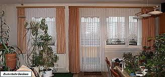 blumenfenster makramégardinen bogenstores