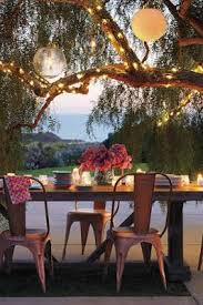 Copper Chairs Outdoor Lanterns And String Lights