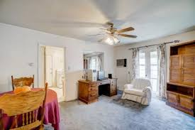 Formal Dining Room With Ceiling Fan And Original French Doors