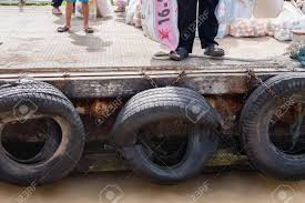Nonthaburi, Thailand - June, 11, 2017 : Old Tires Used As A Bumper ... New Tires Too Big Help Wanted Nissan Frontier Forum Largest For Stock Trd Pro Toyota Tundra Mobile Truck Tires I10 North Florida I75 Lake City Fl Valdosta For Cars Trucks And Suvs Falken Tire Best Suv And Consumer Reports How Big Is The Vehicle That Uses Those Robert Kaplinsky Goodyear Canada Centramatic Automatic Onboard Wheel Balancers Choosing Wheels Ram 3500 Dually Youtube Or Tireswheels Packages Lifted Trucks What Are Right Your At Littletirecom