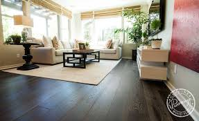 laying hardwood flooring over a concrete slab