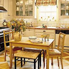 A Renovated Kitchen With Natural Wood Breakfast Table Two Chairs Creamy Cabinets