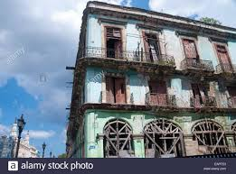 A Rundown And Dilapidated Apartment Building On Side Street Opposite The Capitol In Central Havana Cuba