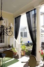 Patio Door Window Treatments Ideas by Tall Black Sheer Window Curtains With White Rod On Ceiling Of