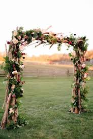 Rustic Wedding Decor Idea A Wood Ceremony Arch Consisting Of Branches Greenery And Jewel Toned Flowers Sterlingbrook Farm Events In Pittstown NJ