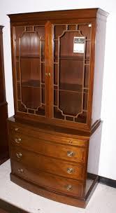 light mahogany bow front two door china cabinet