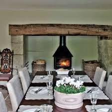 Inspiration For A Large Farmhouse Limestone Floor Dining Room Remodel In Gloucestershire With Wood Stove