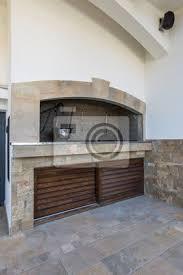 rustikaler grill in outdoor küche in luxus villa außen bilder myloview