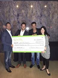 AnnieMac CEO Presents $70 000 Check to Help Kids Affected by