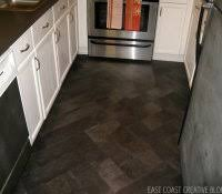 vinyl flooring vs ceramic tile bathroom laminate in bat or kitchen
