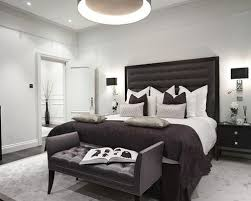 Example Of A Transitional Bedroom Design In London With White Walls And Dark Wood Floors