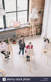 100 Art Studio Loft Above View Portrait Of Students Painting Sitting By Easels