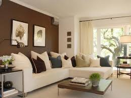 white painted living room wall with l shaped dark brown leather