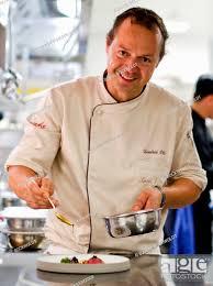 michelin chef hendrik otto prepares a dish in the