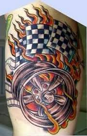 Rally Flames Tattoo On Muscle