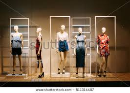 Five Mannequins Standing In Store Window Display Of Womens Casual Clothing Shop Shopping Mall