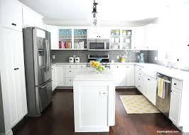 white cabinets dark grey countertops kitchen backsplash countertop
