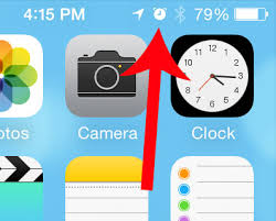 What is the Clock Icon at the Top of My iPhone Screen Solve