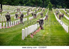 memorial day graveside decorations decorating a soldier s grave on memorial day in one of the