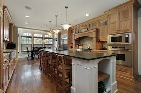Custom Kitchen With White Cabinet Island Dark Countertops And Breakfast Bar