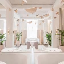 Universal Design Studio Pairs Pink Terrazzo With Grey Velvet For Odette Restaurant Interior