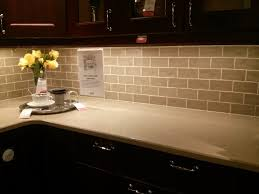interior brown glass subway tile backsplash with flowers on the