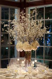 The Table Centerpiece for New Year s Eve with White Flowers and