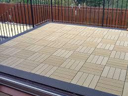 interlocking deck tiles in a hatch pattern with an ebony border