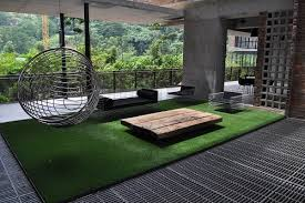 A Green Space With An Artificial Grass Rug