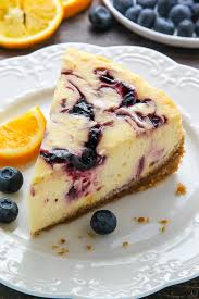 Supremely smooth and creamy homemade Lemon cheesecake topped with fresh Blueberry swirls All layered on