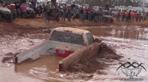 Bad Ass Chevy Battles Through Muddy Hole And Floats To Victory!
