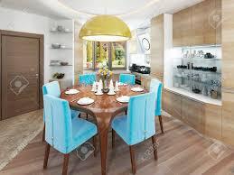 moderne esszimmer mit küche in einem trendigen stil kitsch runder esstisch mit bequemen blauen stühlen und eine große gelbe kronleuchter über dem