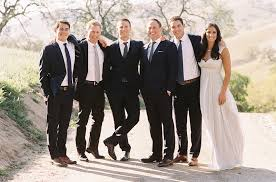 Bride And Groom With Groomsmen In Navy Suits Brown Shoes