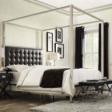 king size metal canopy bed with black faux leather upholstered