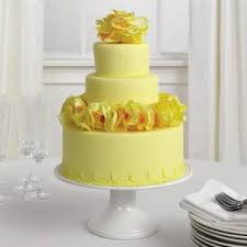 Beautiful bright and cheerful yellow wedding cakes with circular textures