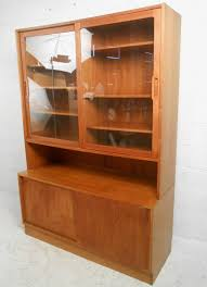 This Beautiful Danish Teak Cabinet Makes A Stylish Storage Option For Any Room Spacious Glass Mid Century Modern