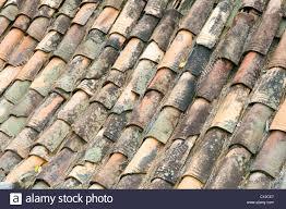 ceramic pottery terracotta roof tiles on rural house on la