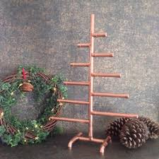 A Tabletop Copper Pipe Christmas Tree Can Be Decorated In Many Ways