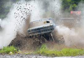 Playing In The Mud: Trucks Try To Make Their Way Through