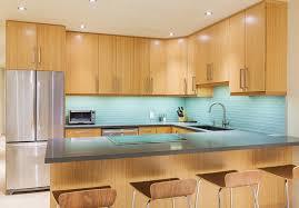 Light Wood Cabinet Kitchen With Blue Tile Back Splash