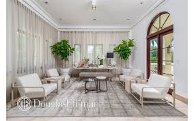 The Living Room Boasts Elegant Vibe With Its Classy Chairs Curtains And Indoor Plants