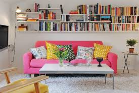 Cute College Girl Apartment Living Room Decorating Ideas With Pink Microfiber Sofa On Grey Carpet And Wall Mounted Book Rack