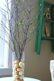 Really Simple Spring Table Decorating Idea Put Inexpensive Plastic Craft Eggs In A Hurricane And Fill With Sticks